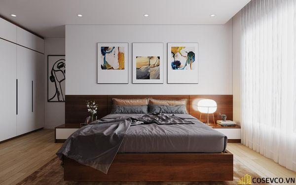 Phòng ngủ master cũng được ứng dụng gỗ MDF với hệ thống giường tủ và kệ tivi đơn giản tinh tế - View 2