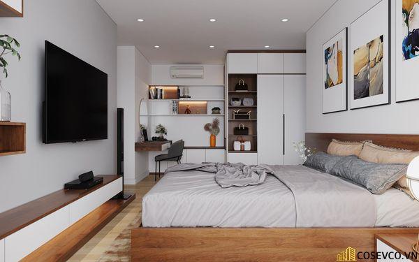Phòng ngủ master cũng được ứng dụng gỗ MDF với hệ thống giường tủ và kệ tivi đơn giản tinh tế - View 3
