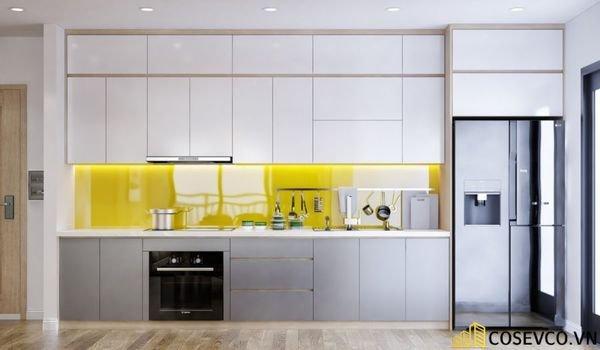 Thiết kế phòng bếp trong căn hộ 70m2 nối liền phòng khách không sử dụng vách ngăn cách thay vào đó là sự khéo léo phân chia không gian